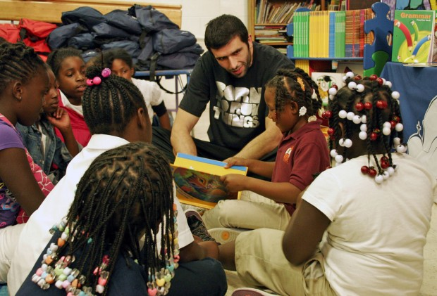 Vladi Reading with Kids